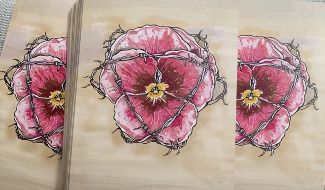 Reverse side of the Next World Tarot deck showing a flower wrapped in barbed wire.